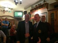 Chairman  Gary Tobin presenting Eddie Collins with St Michaels Blazer after 2014 PIFC 1st Rd Win