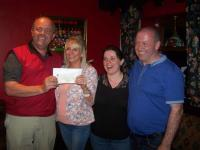 Lillian Fahey being presented with a cheque for €4700