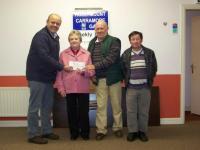 Hollymount/Carramore GAA Club presenting a cheque for €2000 to Teresa Hynes