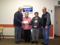 Hollymount/Carramore GAA Club presenting a cheque for €2000 to Teresa Hynes