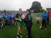 Gemma Heaphy Fe13 Camogie Captain Receiving Trophy