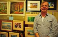 Painter displays his work at Art Expo