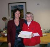 Ailish Barrett makes a presentation to the 2009 Golfer of the Year, Pauline Mangan