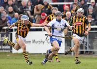 Waterford's Jamie Barron breaks through Kilkenny's Padraig Walsh (5) and TJ Reid (12)