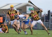 Waterford captain Kevin Moran surrounded by Kilkenny players