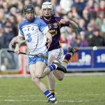 Waterford's Michael Kearney is disposessed by Wexford's Liam Ryan during their National Hurling league match in Wexford Park.
