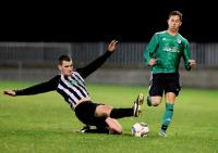 Ryan Shields of Kilmacrennan Celtic making a tackle against Curragh Athletic