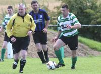 Damien Mc Anenny of Castlefin Celtic in action against Raphoe Town in the Brian Mc Cormick Cup