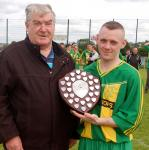 Shane Kelly of Bonage United pictured receiving the Letterkenny Area Shield from League Administrator Terry Leyden.