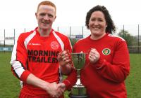 Christina O' Donnell presenting the Division One Cup to Christopher O' Donnell of Drumoghill F.C.