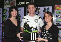 Chris Porter receiving his January Player of the Month award from Corrine Temple and Evelyn Cullen of Brian Mc Cormick Sports