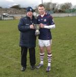 Seamus Finnerty presents the cup to  James Healy