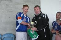 Martin Walsh,Captain, receiving the cup from Tom Mullen of the Mayo Schoolboys/Girls and Youths League. What a great moment!