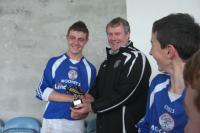 Peter Mc Nicholas receiving the man of the match award from Tom Mullen, Chairman of The Mayo Schoolboys/Girls & Youth Leagu
