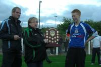 Martin Walsh, Captain of U16 receiving the Division 1 shield from Bridget Mellant of the Schoolboys/Girls League.