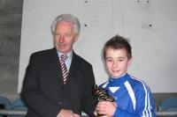 Adam Campbell receiving his man of the match award from Martin O'Hanlon, general secretary of SFAI.