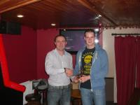 A team manager, Eamon Byrne presenting award to A team player of the year, Neill McNicholas.