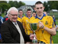 Cian Madden presented with Junior A Football Cup