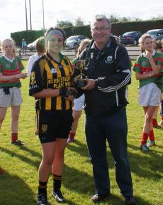 Captain Laura collects the cup from Brendan King
