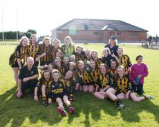 Under 16 girls celebrate with cup