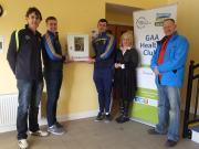 Installing defibrillator sponsored by Irish Life, Healthy Club Project partners. 17 December 2016