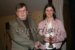 Katie McNamara accepting her trophy from Tom O Sullivan at the 2006 NK finals of Senior Scór